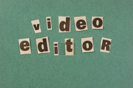 word video editor cut from newspaper on green background