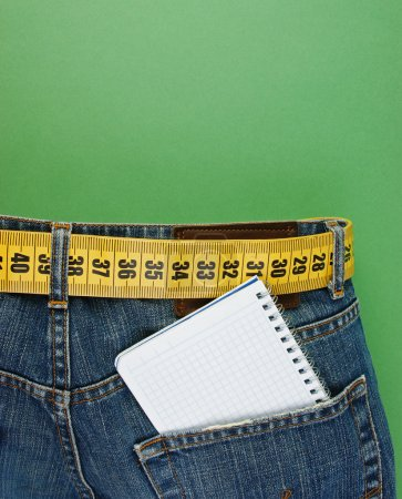jeans with meter belt slimming and notebook in pocket on the gre