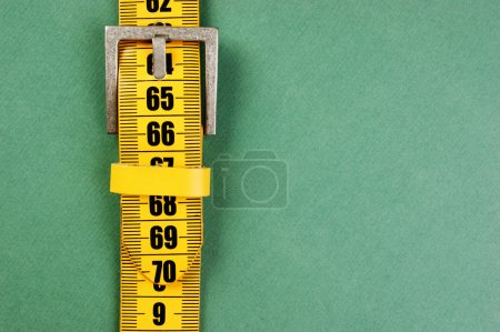 meter belt slimming on the green background
