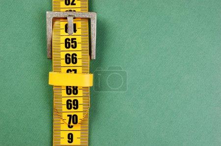 meter belt slimming on the green background