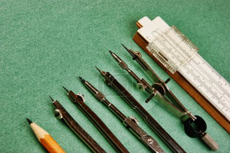 Old drawing tools on a green background