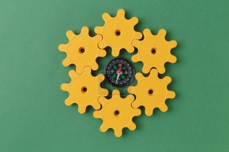 yellow plastic gears and compass