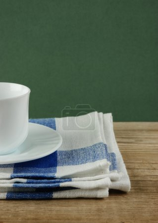 White coffee cup and dishcloth