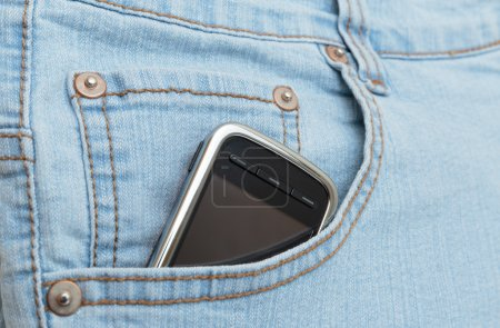 Mobile phone in jeans pocket