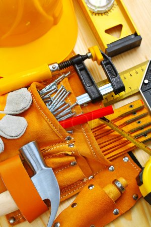 tools in belt and hardhat