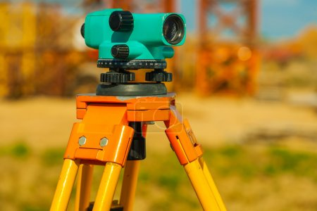 Close up view on old theodolite on construction place