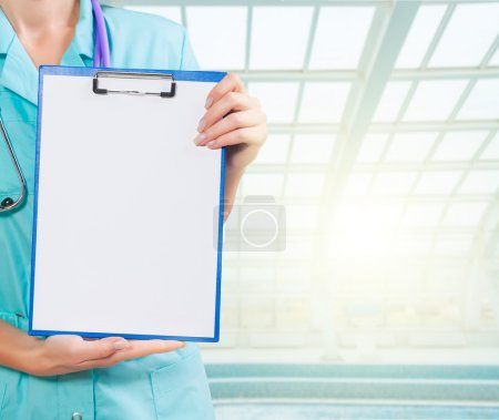 Photo for Hands of female doctor holding clipboard - Royalty Free Image