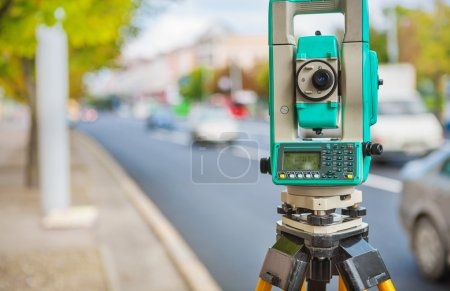 Theodolite on street of small town