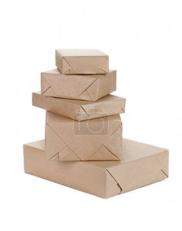 Photo for Stacking parcels boxes with kraft paper, isolated on white - Royalty Free Image