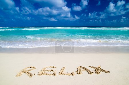 Photo for Word Relax on sand beach - Royalty Free Image