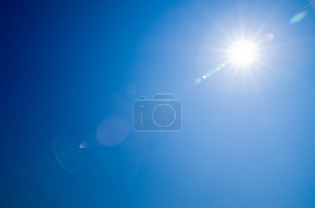 Photo for Shining sun at clear blue sky - Royalty Free Image