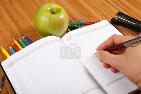 School supplies on a wooden table