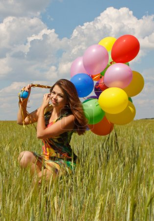 Photo for Happy young woman and colorful balloons - Royalty Free Image