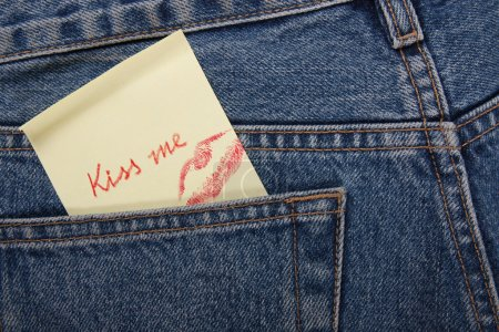 Sticker in your pocket jeans. The text - Kiss me.