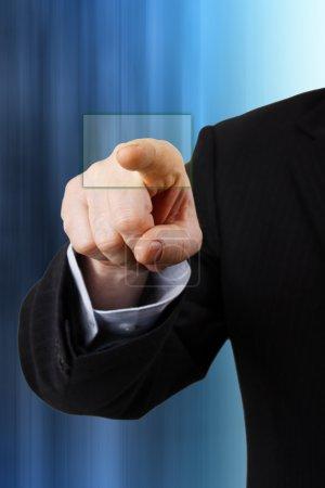 A businessman pressing a virtual button
