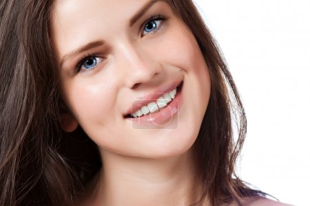 Portrait of young beautiful woman with perfect smile