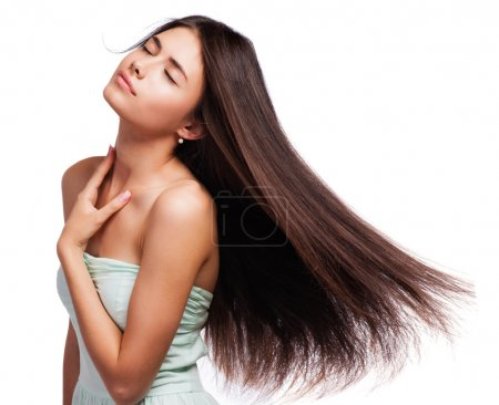 Portrait of a beautiful young woman with hair flying