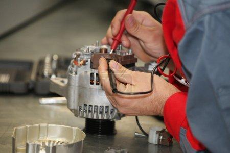 mechanic restores a generator