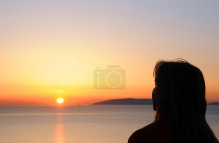 Woman Silhouette at Sunrise