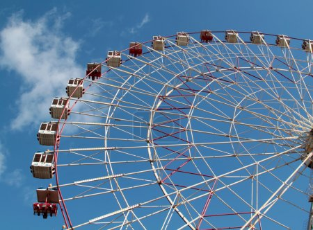 Large Ferris wheel on the blue sky