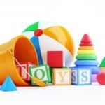 Toys alphabet cube, beach ball, pyramid on a white...