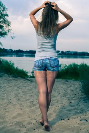 Photo for Back view of standing woman. beautiful girl. backside view of person. Rear view people. - Royalty Free Image