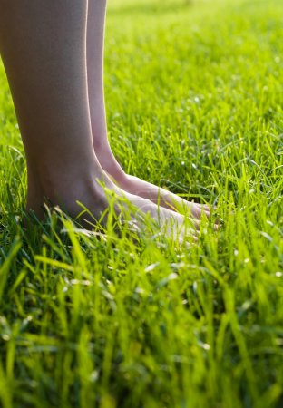 Foot in the grass.