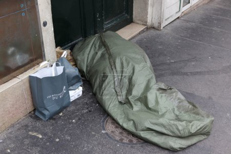 Homeless Sleeping on the Streets in a Sleeping Bag Outdoors