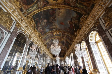 PARIS - APRIL 28 2013: Hall of mirrors full of tourists in the P