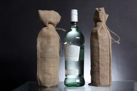 Photo for Bag for water or alcohol made out of recycled Hessian sack with bottle - Royalty Free Image