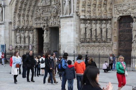 Unidentified people in front of the Notre Dame cathedral of Paris, France,