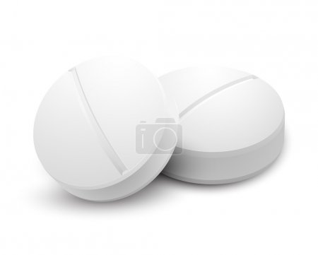 Two pills isolated on white