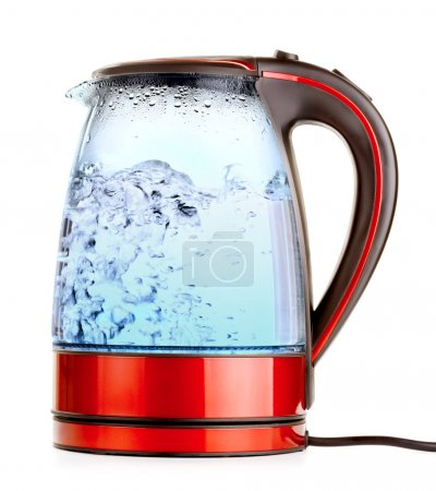 Glass electric kettle with boiling water, isolated...