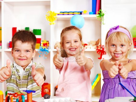 Photo for Group of children in preschool thumb up. - Royalty Free Image