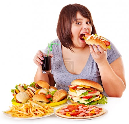 Overweight woman eating fast food....