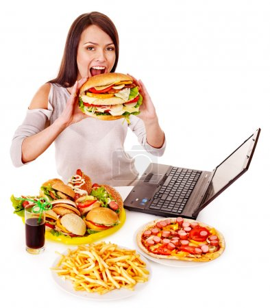 Photo for Woman eating fast food at work. Isolated. - Royalty Free Image