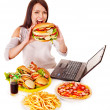 Woman eating fast food at work. Isolated....
