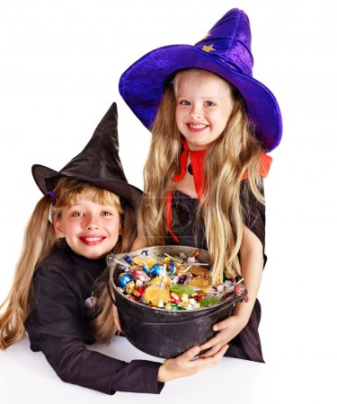 Witch children with trick or treat.