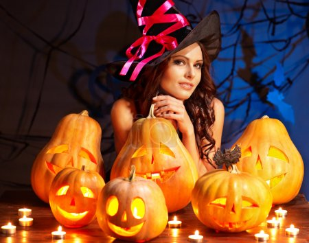 Photo for Witch woman with group Jack O'Lantern. - Royalty Free Image