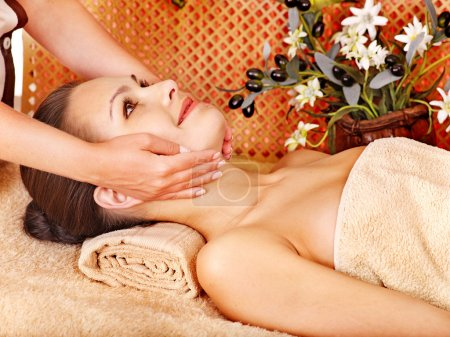 Photo for Woman getting head massage in tropical beauty spa. - Royalty Free Image