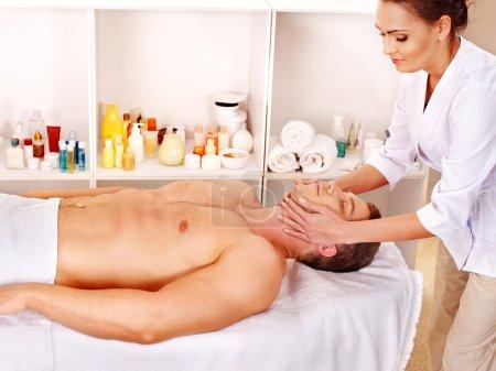 Man getting facial massage .