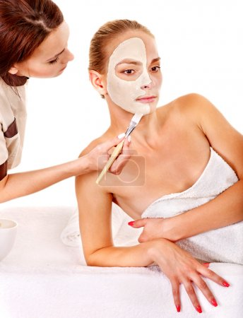 Photo for White woman getting facial mask in tropical beauty spa. - Royalty Free Image