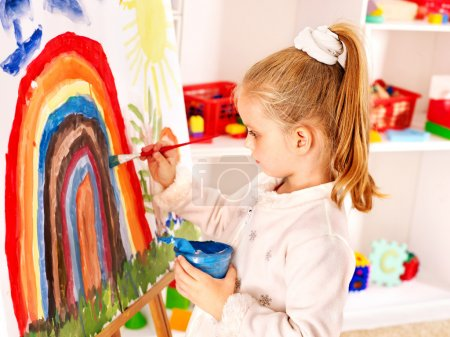 Photo for Child drawing on the easel at school. - Royalty Free Image