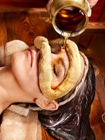 Photo for Woman having facial oil eyes mask at ayurveda spa. - Royalty Free Image