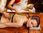 Woman having Ayurvedic spa massage.