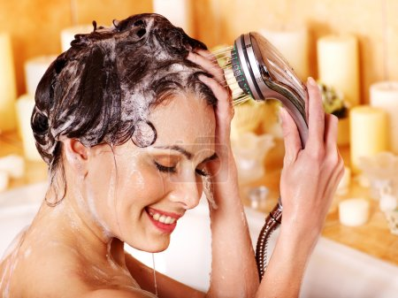 Photo for Woman washes her head at home bathroom. - Royalty Free Image