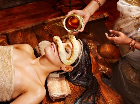 Woman having mask at ayurveda spa.