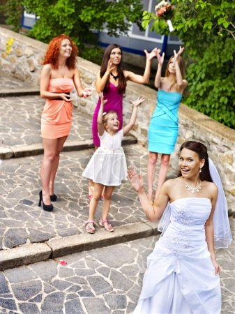Photo for Bride throwing bouquet. Outdoor. - Royalty Free Image