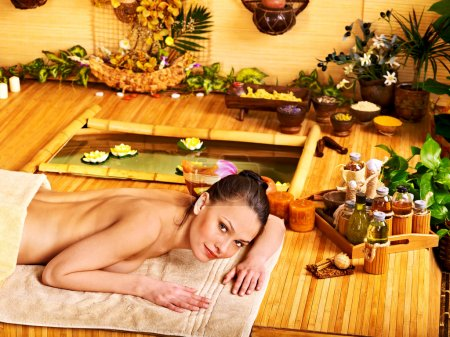 Woman getting stone therapy massage