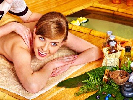 Woman getting aroma massage